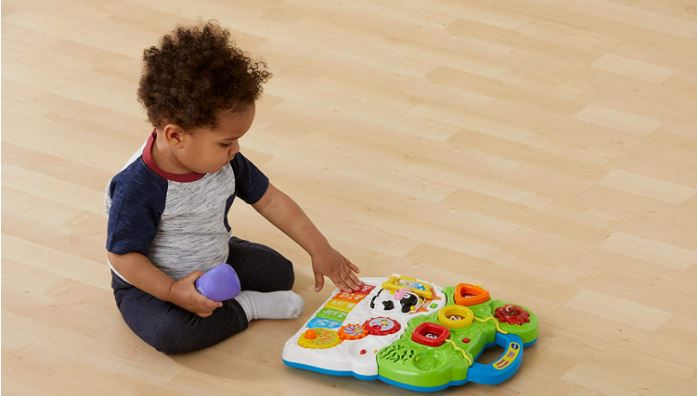 Baby playing with VTech Sit-to-Stand Learning Walker