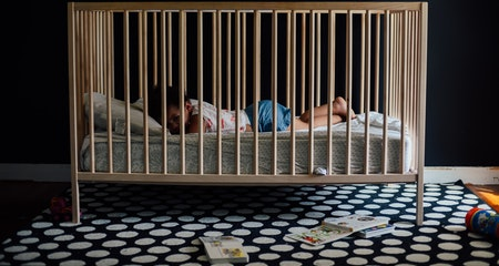 Toddler girl laying in the crib
