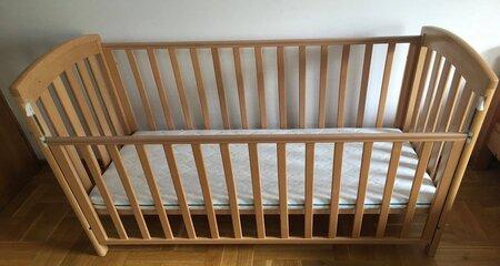 Baby Crib with white lower crib mattress