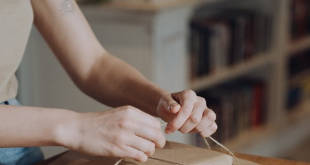 A person is tying up the book