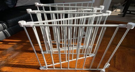 White wide Baby gate to baby Proof Bookshelf area