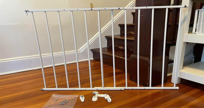 A baby gate next to the stairs