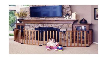 Babysitting next to the fireplace area that covered with Pressure Mounted Baby Gate